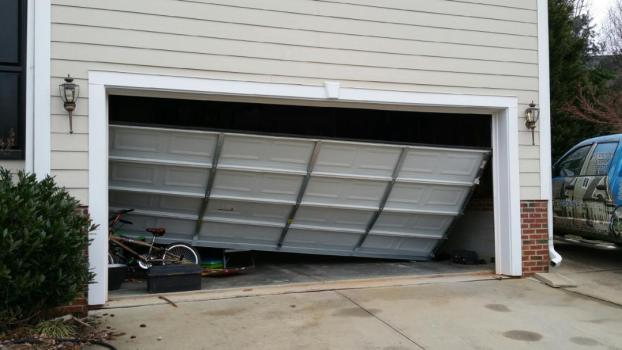 Broken residential overhead garage door