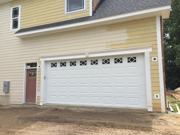 Garage installed on a new yellow home